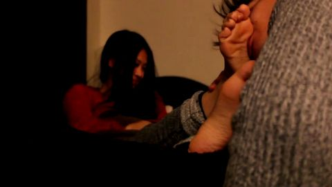 Beautiful Asian girlfriend gets her sexy ticklish feet worshipped by her partner