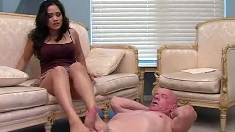 Busty Jessica Bangkok gives her slave a nice footjob and takes a piss in his mouth