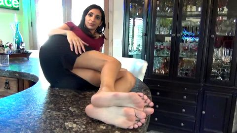 Slutty bartender showing off her exotic soles and feet at work