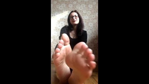 Nerdy Russian girl sitting on her floor playing with her delicious feet