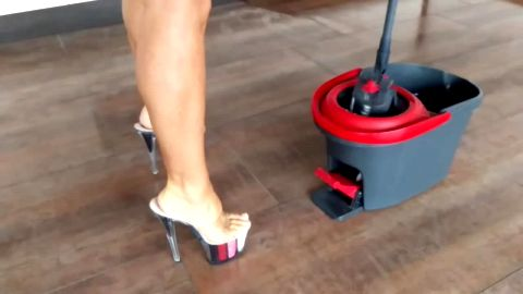 Bombshell cleaning the floor in sexy platform high heel shoes and tiny denim shorts