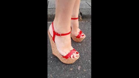 red high heels wedge walking in street