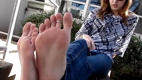 Gorgeous girl showing a horny stranger her long feet and sexy toes outdoors