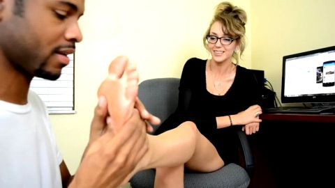 Cute black guy tickles a sexy office lady's delicious feet with a toothbrush