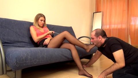 Stunning young blonde mistress brutally punishes her male foot slave