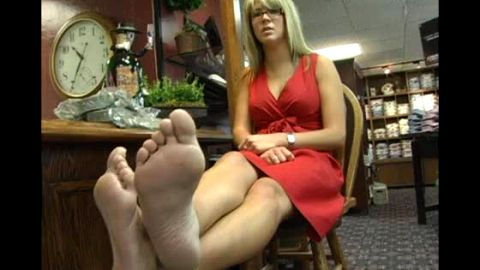 Big boobed MILF in tight red dress flaunts her mature feet in the store