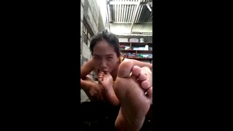 Cute flexible Asian babe sucking her own delicious toes in abandoned place