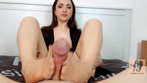 Slutty MILF in stockings Olga pleasures a stiff dick with her feet in POV