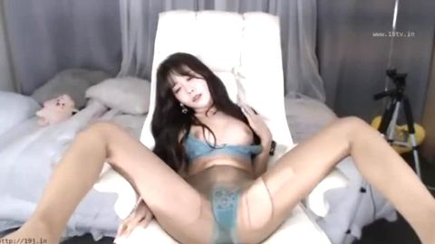 Lonely Asian stunner worships her own sexy feet and legs in nylon stockings
