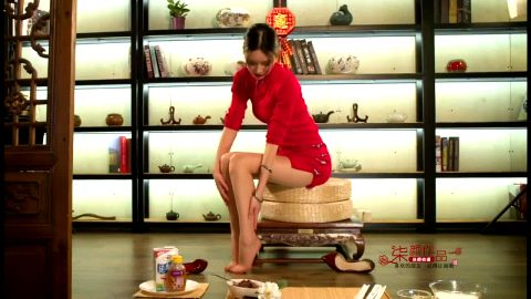 Incredibly sexy Asian housewife in stockings makes a traditional dish using her skilled feet