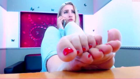 Beautiful Ukrainian blonde reveals her sweet red toe nails and feet on the cam