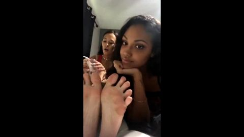 Two sexy college babes show off their magical feet as they smoke a joint