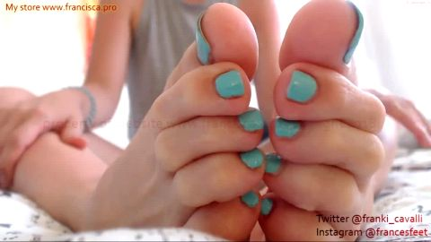 Amateur doll puts baby oil on her sexy feet with turquoise nail polish and teases