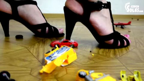 Mad amateur girl crushing car toys with her black high heel shoes (Czech Soles)