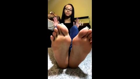 Delicious ebony girl exposing her caramel feet with long blue toe nails