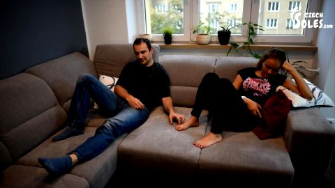 Bossy barefoot girlfriend in jeans humiliating her boyfriend on the sofa (Czech Soles)