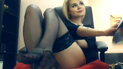 Glamour blonde Russian model does miracles with her feet on the webcam