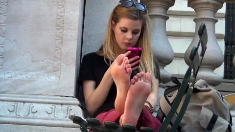 Smoking hot barefoot teen captured talking on the phone in public