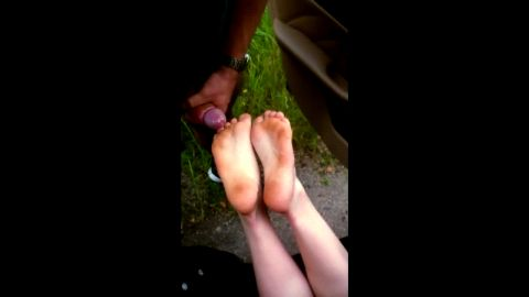 Cumshot on sexy amateur feet in the middle of nowhere