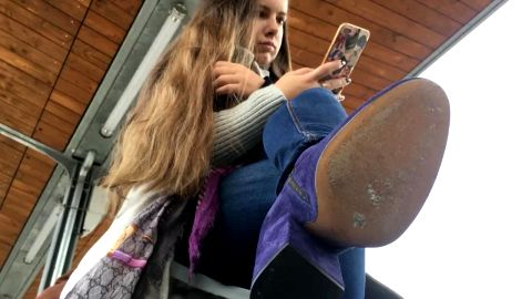 Pretty teen in interesting purple boots filmed by voyeur at the bus station