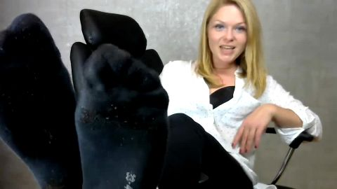 German blonde mistress in black socks gives an intense virtual footjob