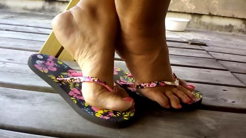 Sexy mature feet with pink nail polish cannot stay calm in flip flops