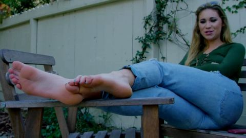 Amateur blonde laying on the table outdoors showing off her brilliant feet