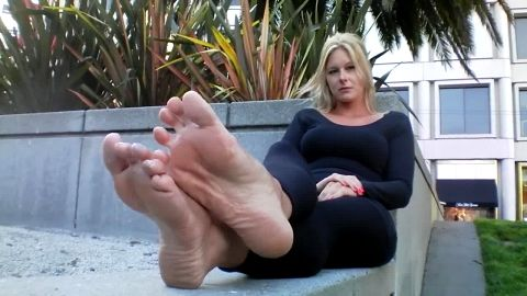 Blonde doll revealing her huge smelly feet in public and she loving it