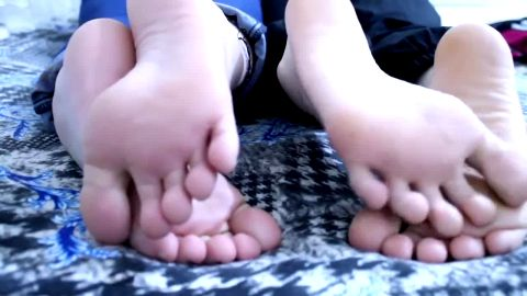 Two playful college babes let me film them close up as their take smelly socks off