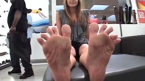 Crazy amateur girl flaunts her dirty feet at the shoe store
