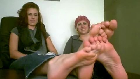 Playful college sluts playing with their naked feet at the office