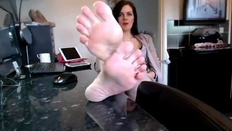 Kinky redhead secretary showing her amazing mature feet and red toe nails at work