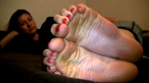 long feet soles close up