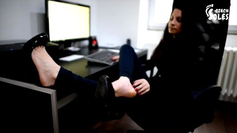 Wonderful brunette goes barefoot while working at the computer (Czech Soles)