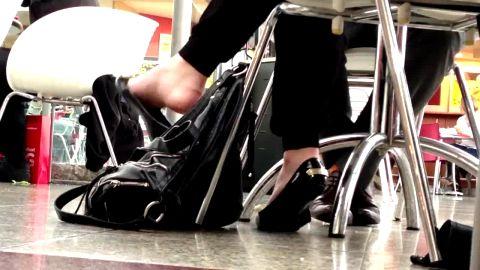 Pervert films amateur woman in public dangling her black ballerinas