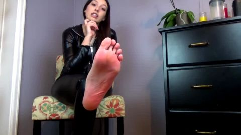 Teenage princess looks sexy showing off her naked feet in tight black outfit