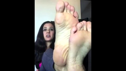 Charming housewife showcases her soft soles on her private cam