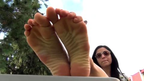 Gorgeous amateur brunette gets her beautiful feet and soles filmed in public