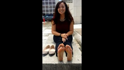Charming amateur woman has no shame showing off her Asian feet in public