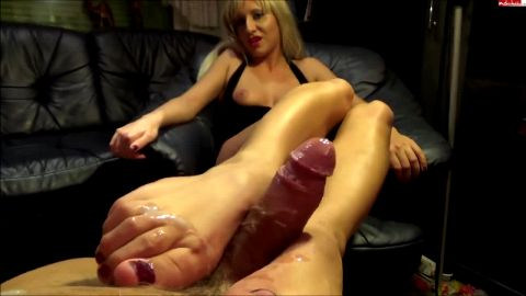 Exotic blonde German mistress gives passionate footjob to her lover