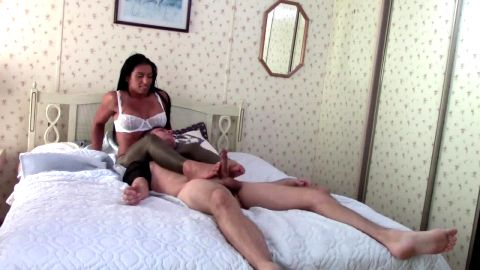 Bossy Latina gives an interracial footjob to her white foot slave