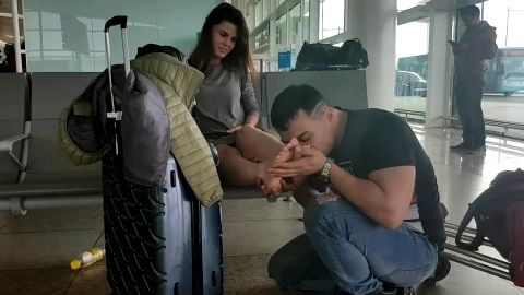 Crazy boyfriend worships his girlfriend's delicious feet at the airport
