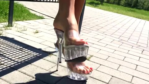 Long legged goddess walking in public in high heels and see through dress