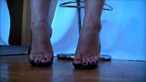 Sophisticated amateur woman loves posing in her high heel sandals