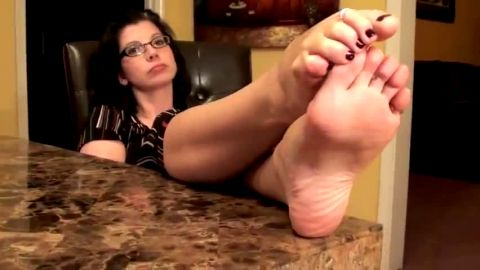 Sweet housewife sitting in the chair touching her phenomenal feet and toes