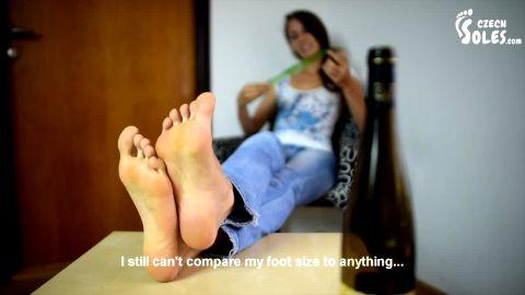 Skinny brunette in jeans measuring her long amateur feet Czechsoles