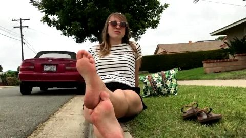 Sweet amateur teen with sunglasses sunbathing her soft feet outdoors