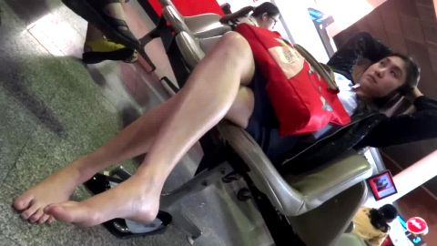 Lovaly Asian businesswoman caught sitting in the chair barefoot in public