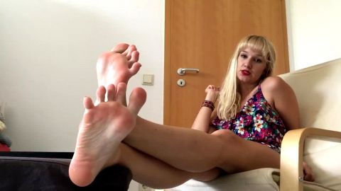 Lusty bitch in dress shows off her yummy feet while talking dirty