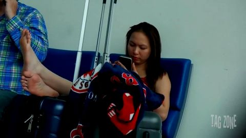 Asian woman flaunts her sensitive feet & toes on the airport